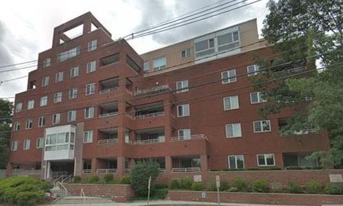 exterior view of brick condominium building