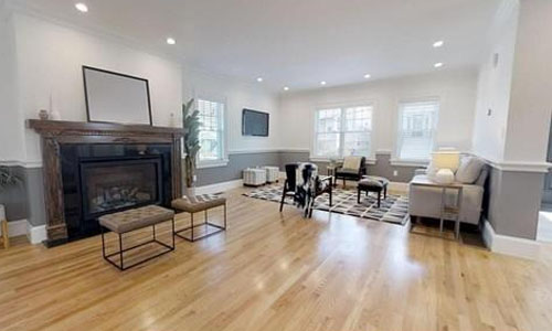 view of interior open concept floor plan - with gray and white walls, fireplace and hardwood flooring