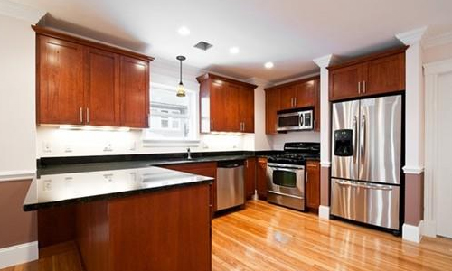 beautiful kitchen with hardwood floors, stainless steel appliances, cherry cabinets and granite countertops