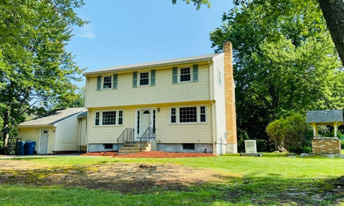 Four bedroom Colonial style home for sale in Tewksbury, MA