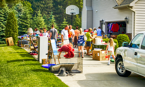 Lots of people shopping at a yard sale