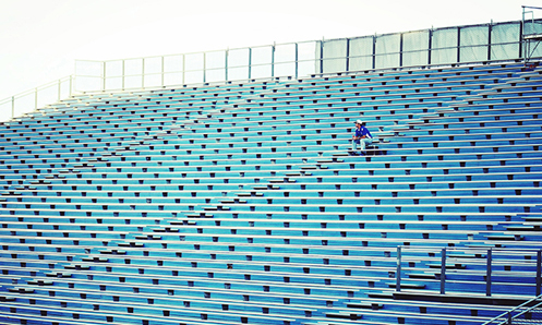 person sitting alone in a stadium