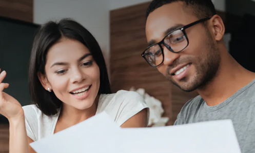 Young woman and man looking at paperwork