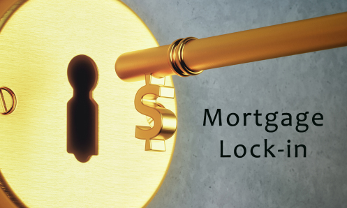 brass key with dollar sign entering lock, words Mortgage Lock-in