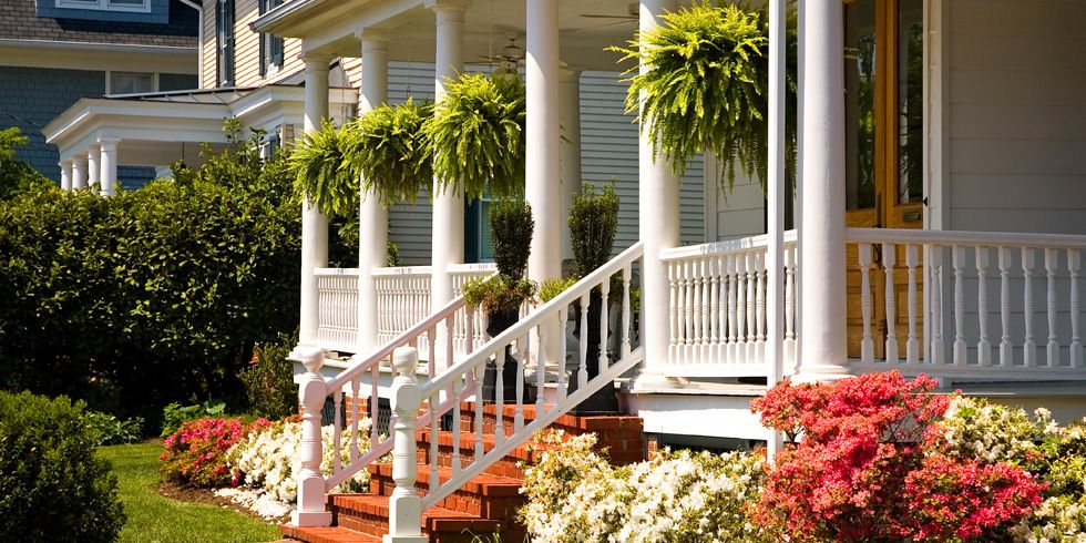 front porch with lots of flowers