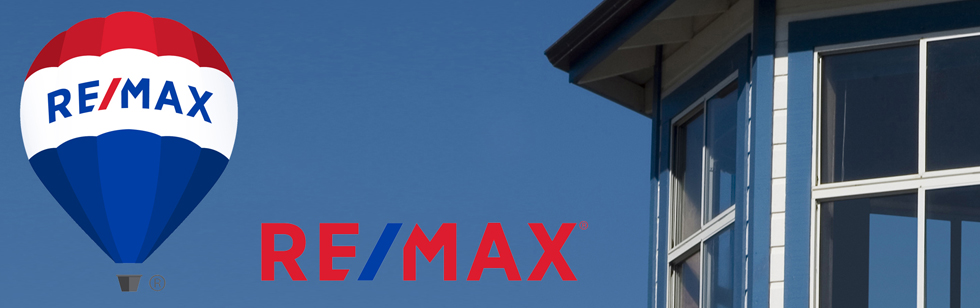 REMAX balloon and word logo near blue house