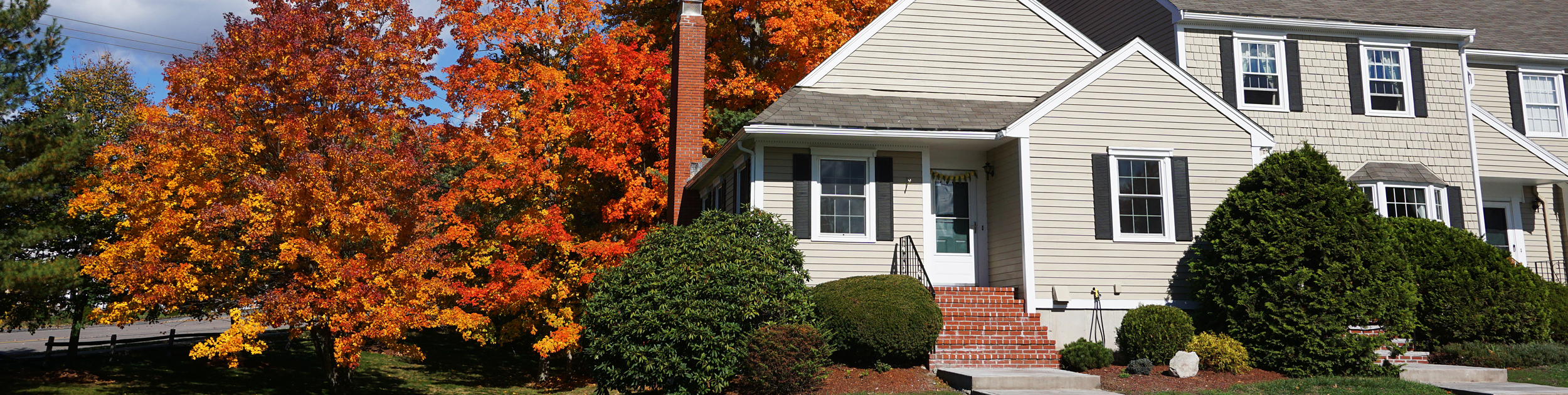 beautiful home with Fall foliage surrounding it