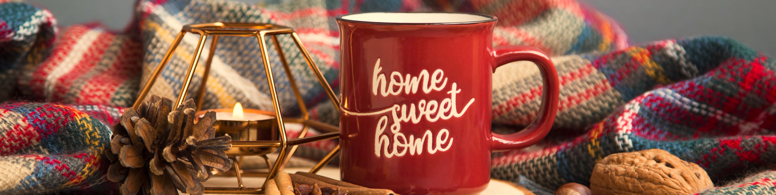 Home Sweet Home mug shown by fireplace