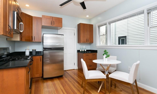 One Bedroom Condo for sale in Somerville, MA - kitchen with hardwood floor and stainless steel appliances shown
