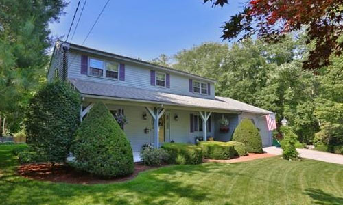 Detached Blue/gray Colonial - front of property with covered porch and beautiful landscaping