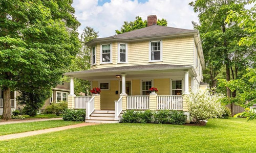 Detached Yellow Colonial, for sale in Reading, MA - exterior of property shown