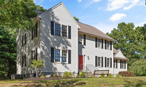 Detached Yellow Colonial for sale in North Reading, MA - exterior of property shown