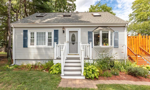 Detached Gray Cape for sale in North Reading, MA - exterior of property shown