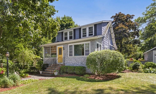 Detached Blue Colonial for sale in Reading, MA - exterior of property shown