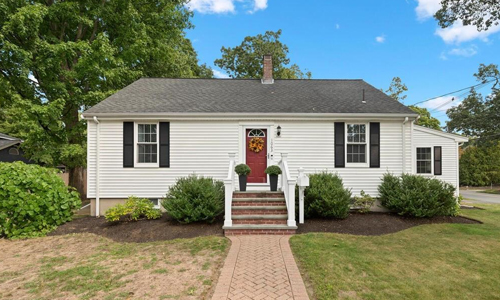 Detached White Cape for sale in Reading, MA - exterior of property shown