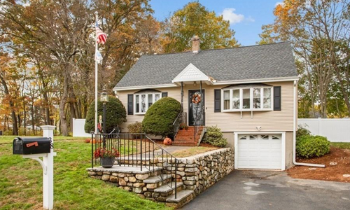Four bedroom cape style home for sale in Methuen, MA - exterior of home shown
