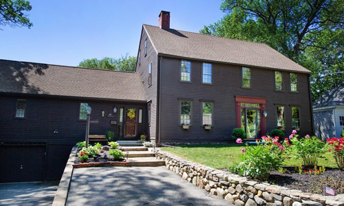 Detached Brown Colonial for sale in Merrimac, MA - waterfront property - exterior of home shown