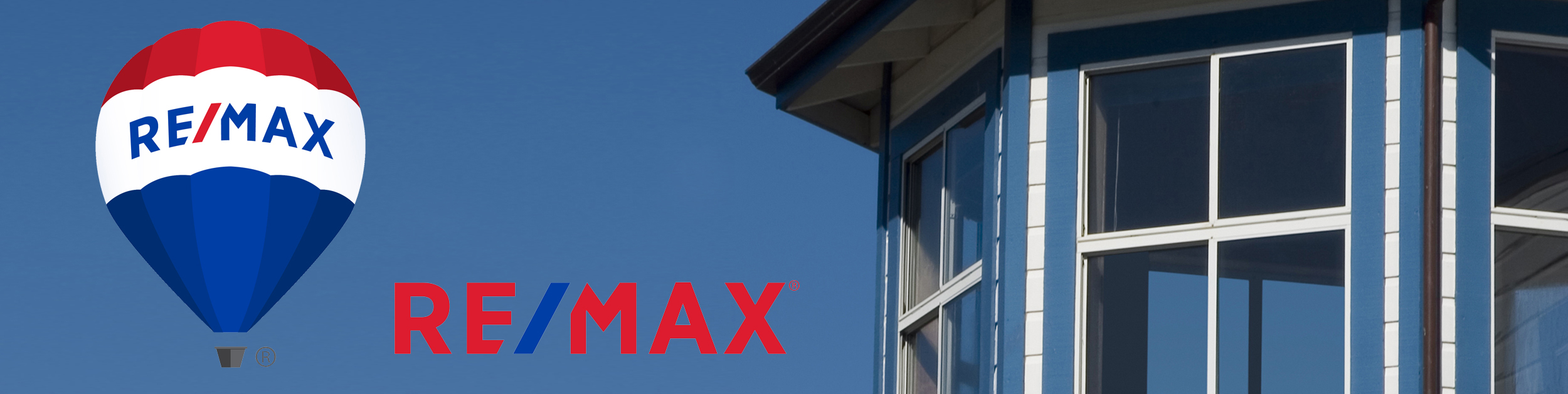 section of windows on blue home shown with white trim and REMAX balloon and word logo to the left