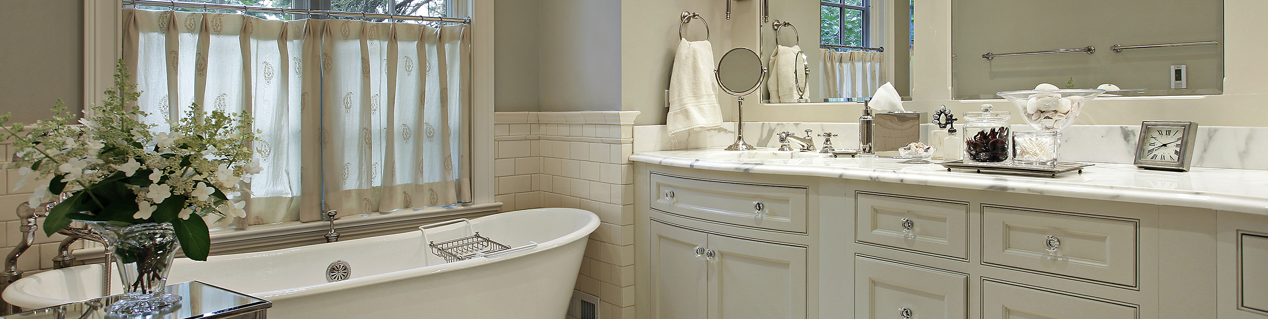 view of a bathroom with white tub, counters and counter top
