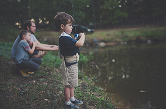 Child Fishing with Father