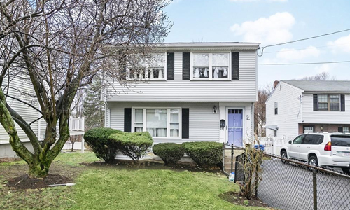 Detached Grey Colonial for sale in Waltham MA - exterior of home shown