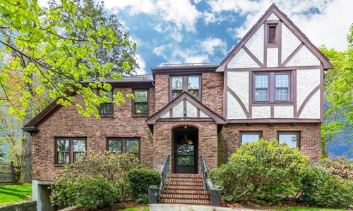 Detached Brick Tudor for sale in Newton MA - exterior of home shown