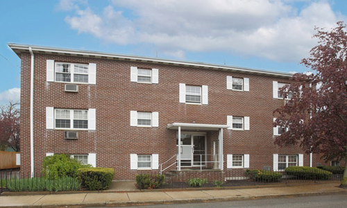 one bedroom garden style condo for sale in Waltham MA - exterior of brick building shown