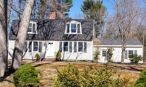 Four bedroom Colonial style home sold in Somersworth NH - exterior of of home shown