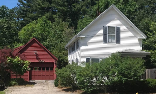 Three bedroom New Englander style home sold in Somersworth NH - exterior of of home shown