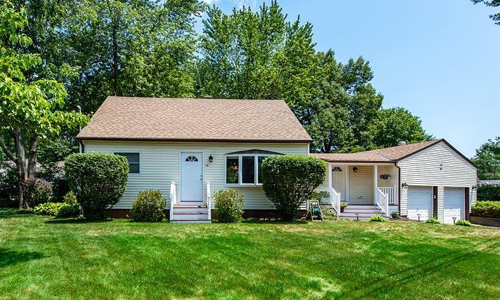 Four bedroom cape style home sold in Dover NH - exterior of of home shown