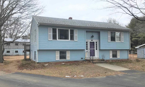 Two bedroom ranch style home for sale in Rochester NH - exterior of of home shown