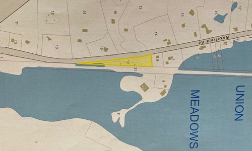 Land for sale in Wakefield - land is a long triangular shape and very close to Union Meadows Pond