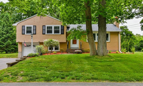 Detached Multi Level home for sale in Dedham, MA - exterior shown