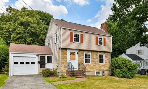 Three bedroom Detached Beige Colonial for sale in Dedham, MA - exterior of home shown