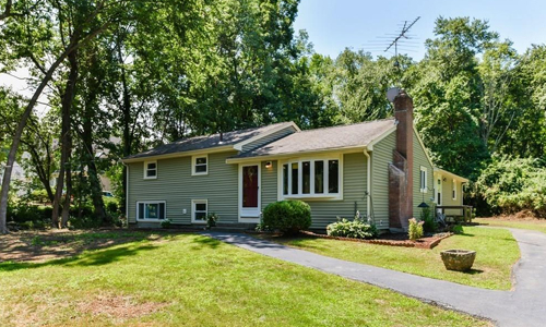 Four bedroom multi level single family home for sale in Millis, MA - exterior of home shown