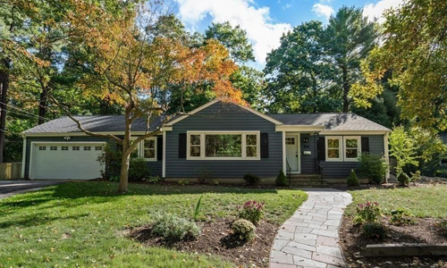 Four bedroom Detached Blue Ranch for sale in Westwood, MA - exterior of home shown