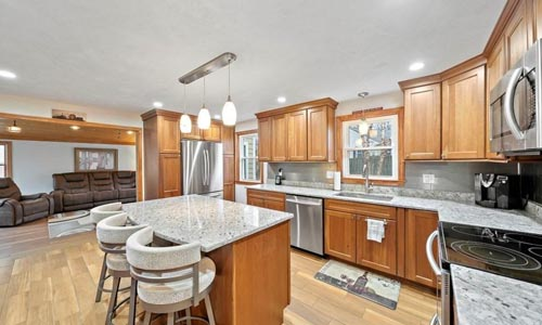 Four bedroom Colonial, Cape in Randolph, MA - view of kitchen is shown