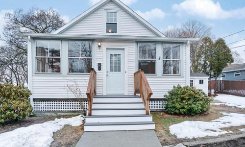 Four bedroom detached white bungalow for sale in Dedham, MA