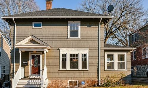 3 bedroom colonial style home in Boston MA - tan with red door and white trim