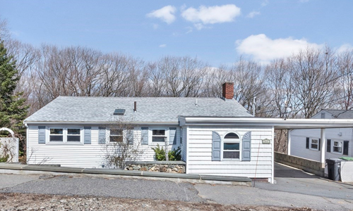 3 bedroom multi level Ranch style home for sale in Dedham, MA - white with blue shutters