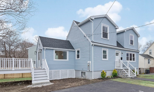 3 bedroom Cape style home for sale in Dedham, MA - light blue with white trim