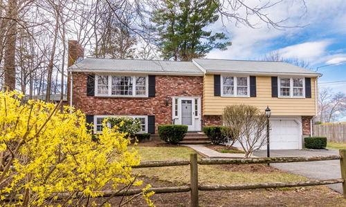 3 bedroom Ranch style home in Dedham, MA - part brick front, white trim, black shutters