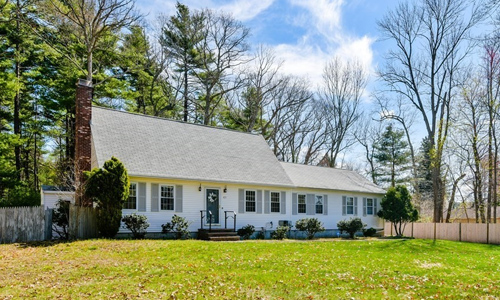 3 bedroom Cape style home for sale in Sharon, MA - light gray with darker gray shutters