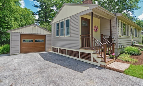 Detached Tan Ranch for sale in Westborough, MA - exterior of home shown