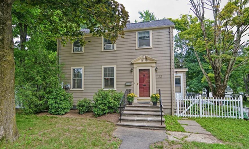 Detached Beige Colonial for sale in Westborough, MA - exterior of home shown