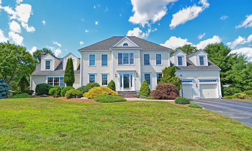 Detached Yellow Colonial for sale in Westborough, MA - exterior of home shown