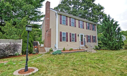 Detached Tan Colonial for sale in Millis, MA - exterior of home shown