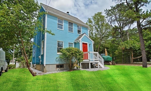 Detached Ocean Blue Colonial for sale in Plymouth, MA - exterior of home shown