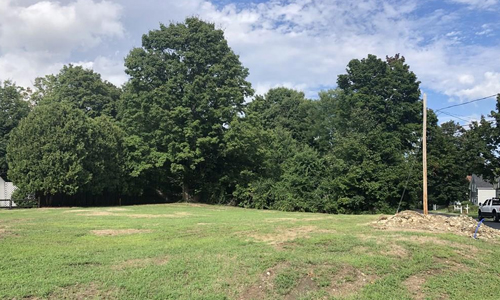 Residential Land for sale in Westborough, MA - grassed area and trees shown
