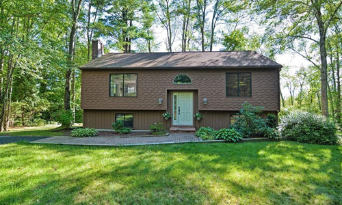 Detached Brown Split Entry for sale in Westborough, MA - exterior of home shown